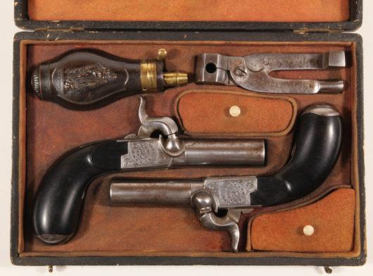12740 - Paar Perkussionstaschenpistolen im Originalkasten